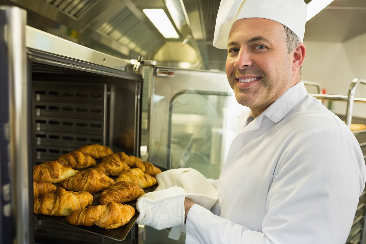 Baker with croissants
