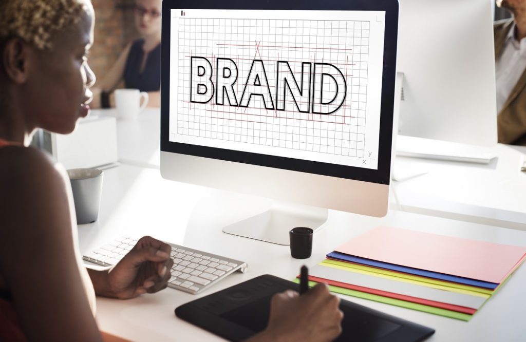 Graphic designer creating a brand logo