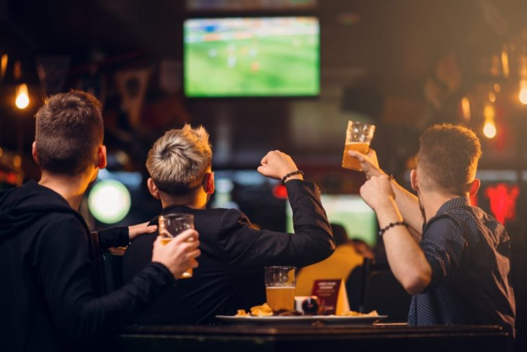 Male group of friends watching a game