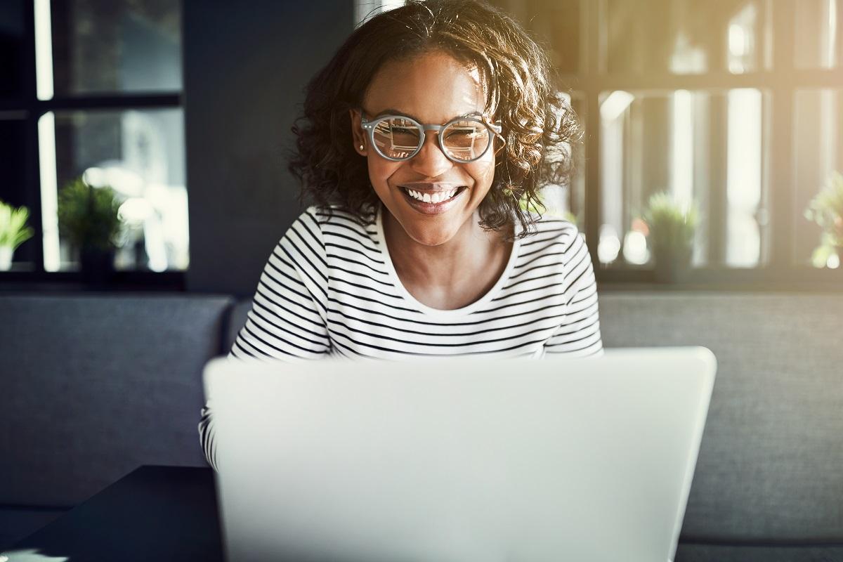 Happy female using her laptop