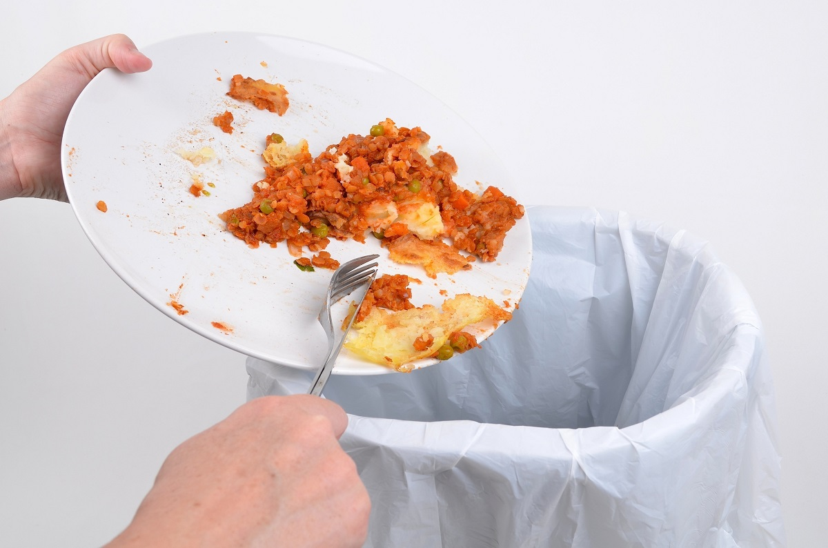 person throwing away food