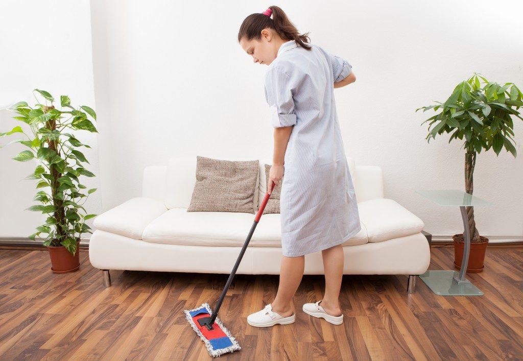 housekeeping staff mopping the floor