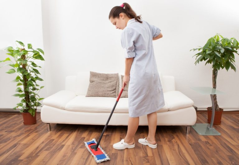 housekeeping staff mopping the floor