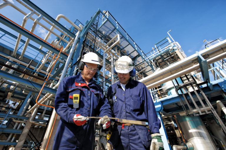 Two engineers in oil production company