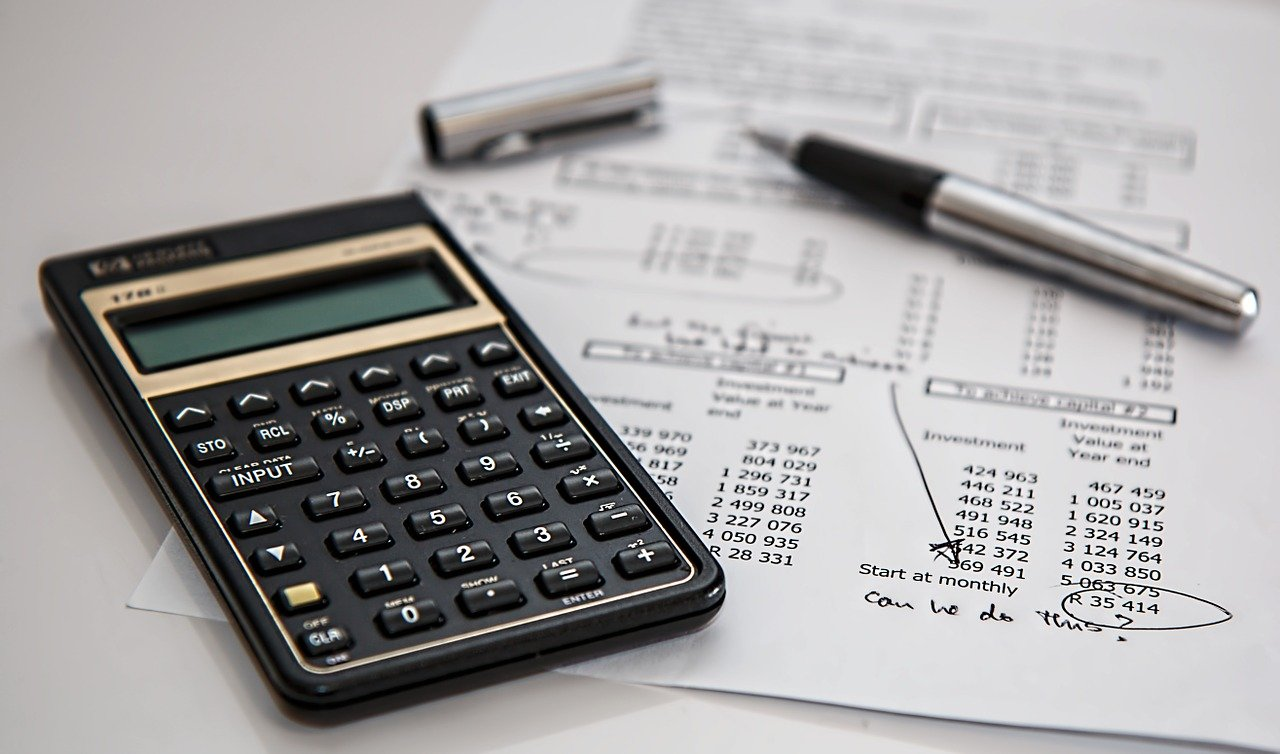 calculator and paper with budgets