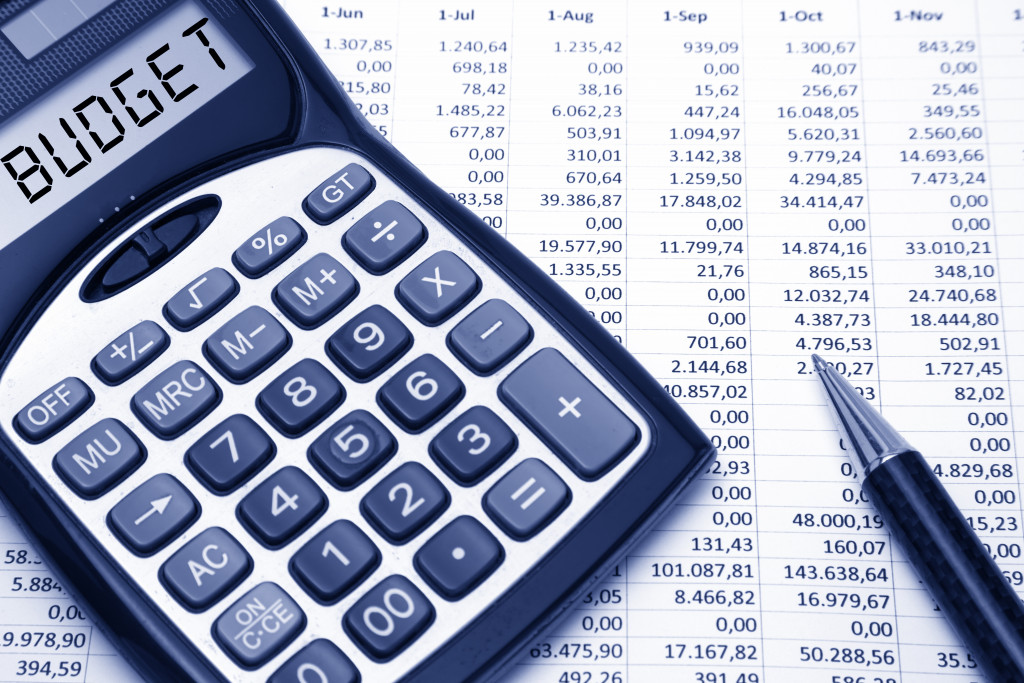 calculator, pen and spreadsheet