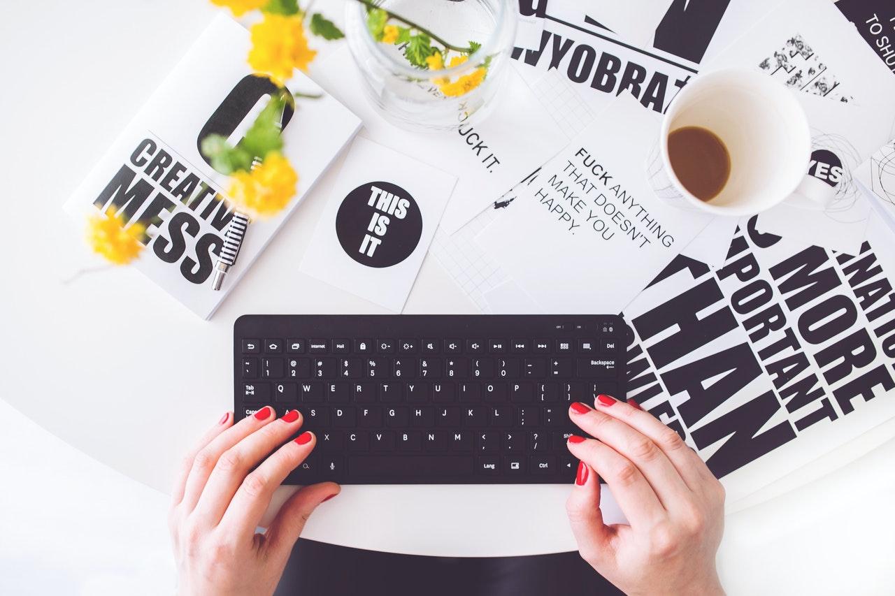 writer on a keyboard