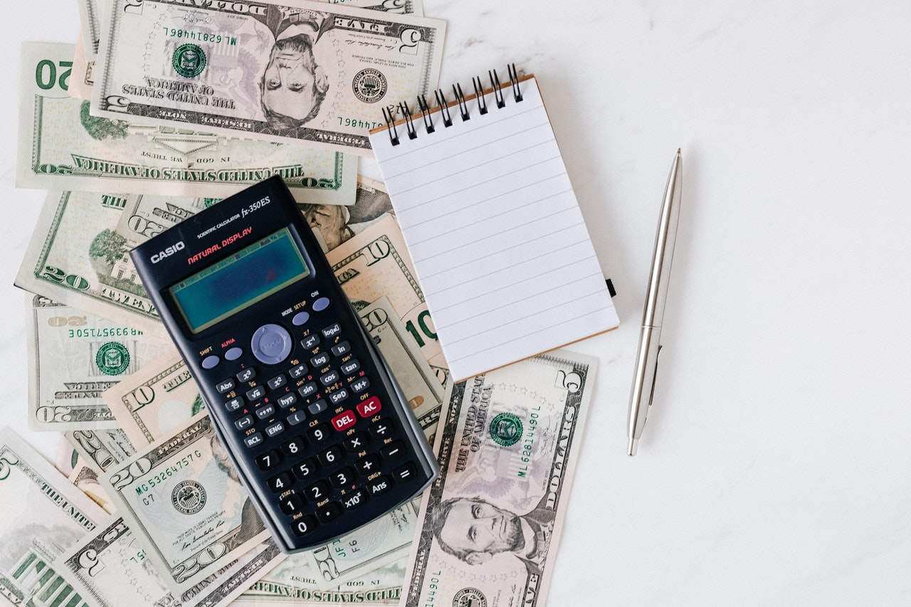 calculator cash and a notepad together