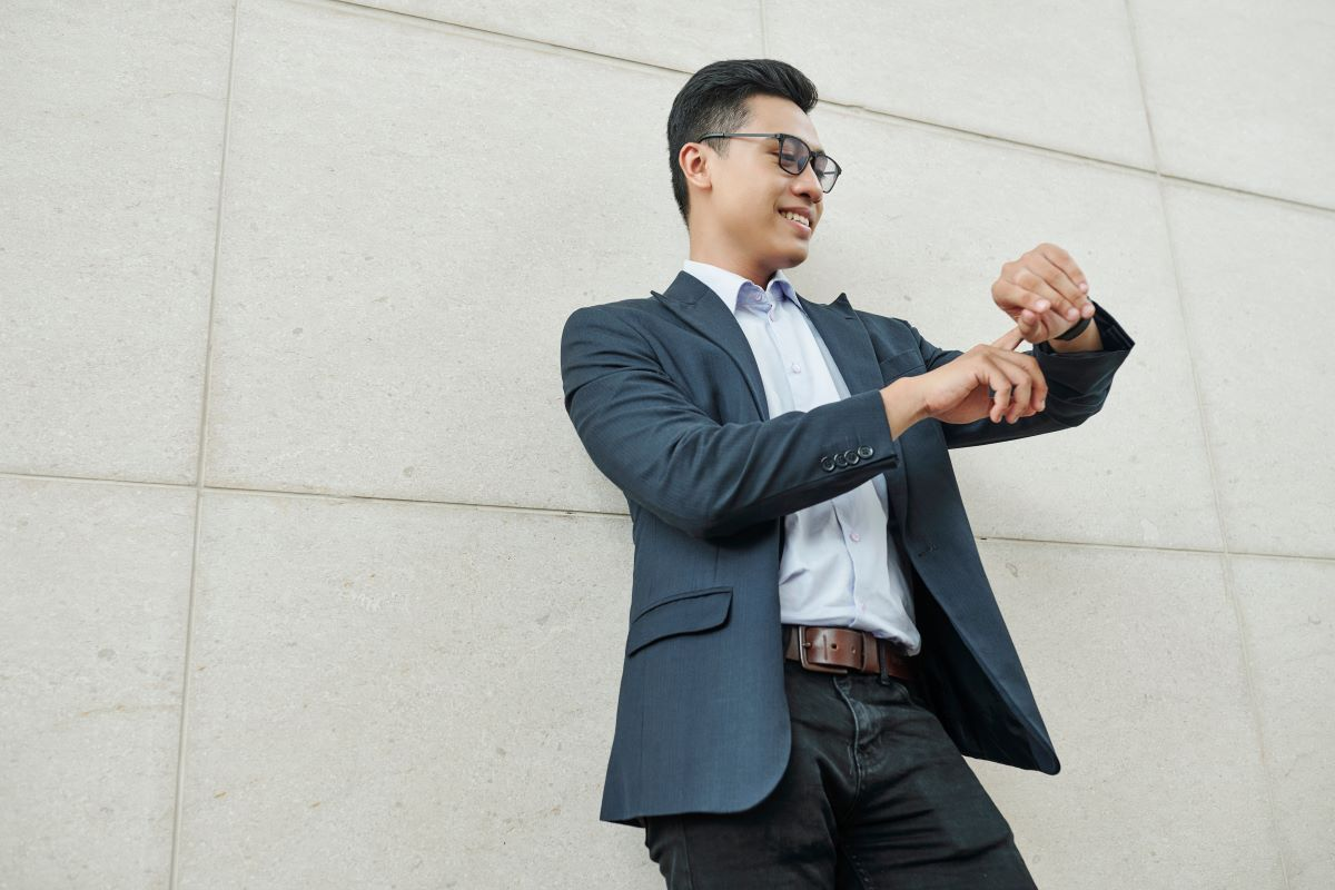 well dressed man pointing at his watch