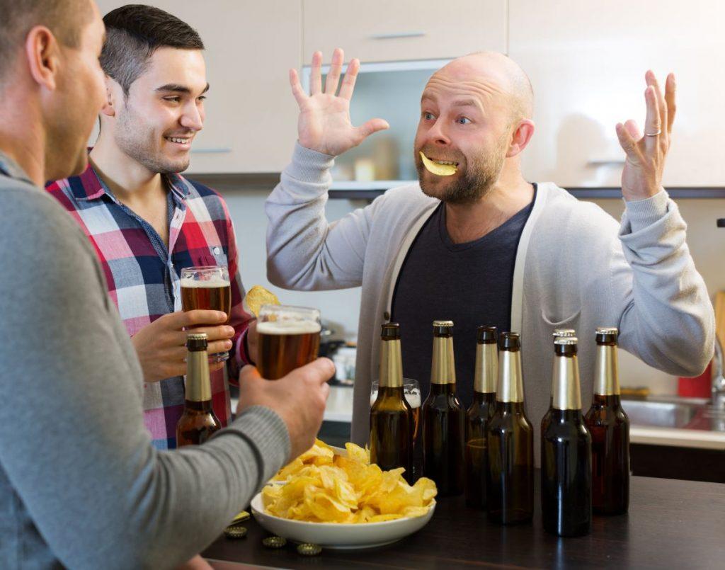 three men at house party