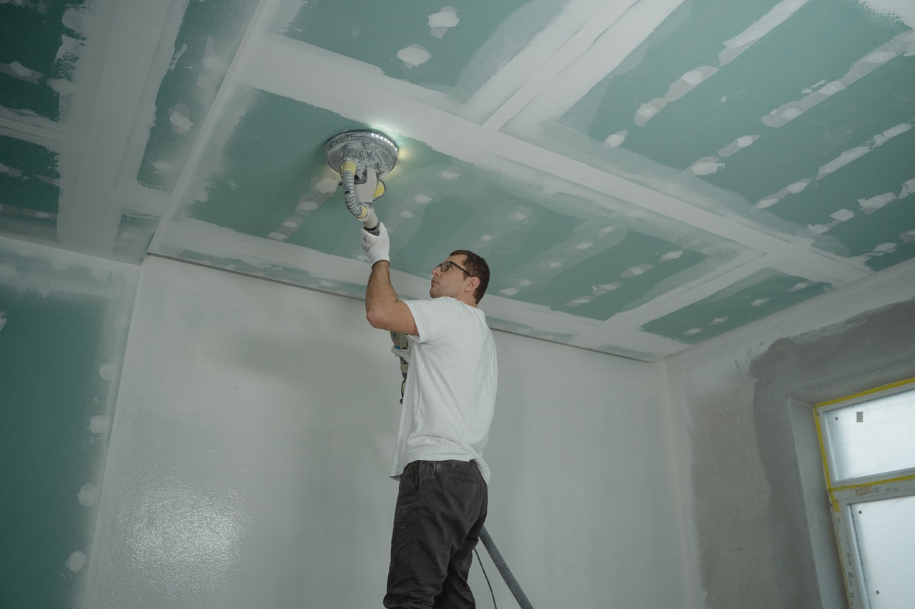 person polishing the ceiling