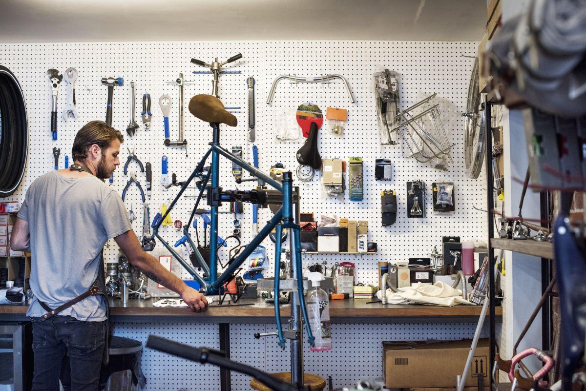 man working on bike in a bike shop