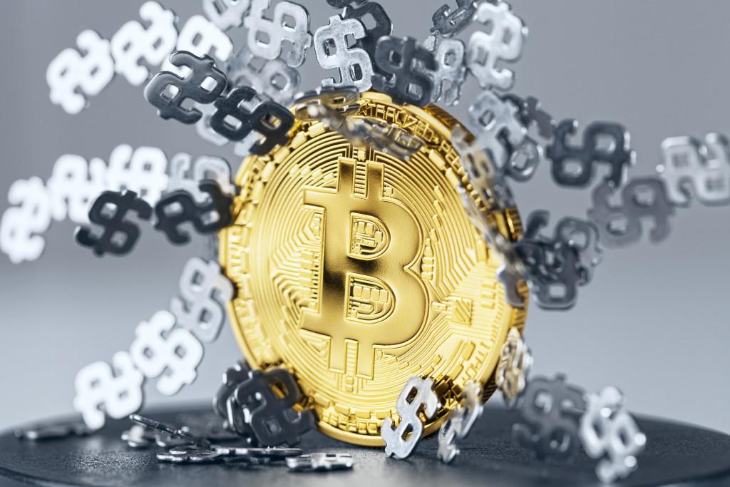 Dollar signs stuck gold Bitcoin.